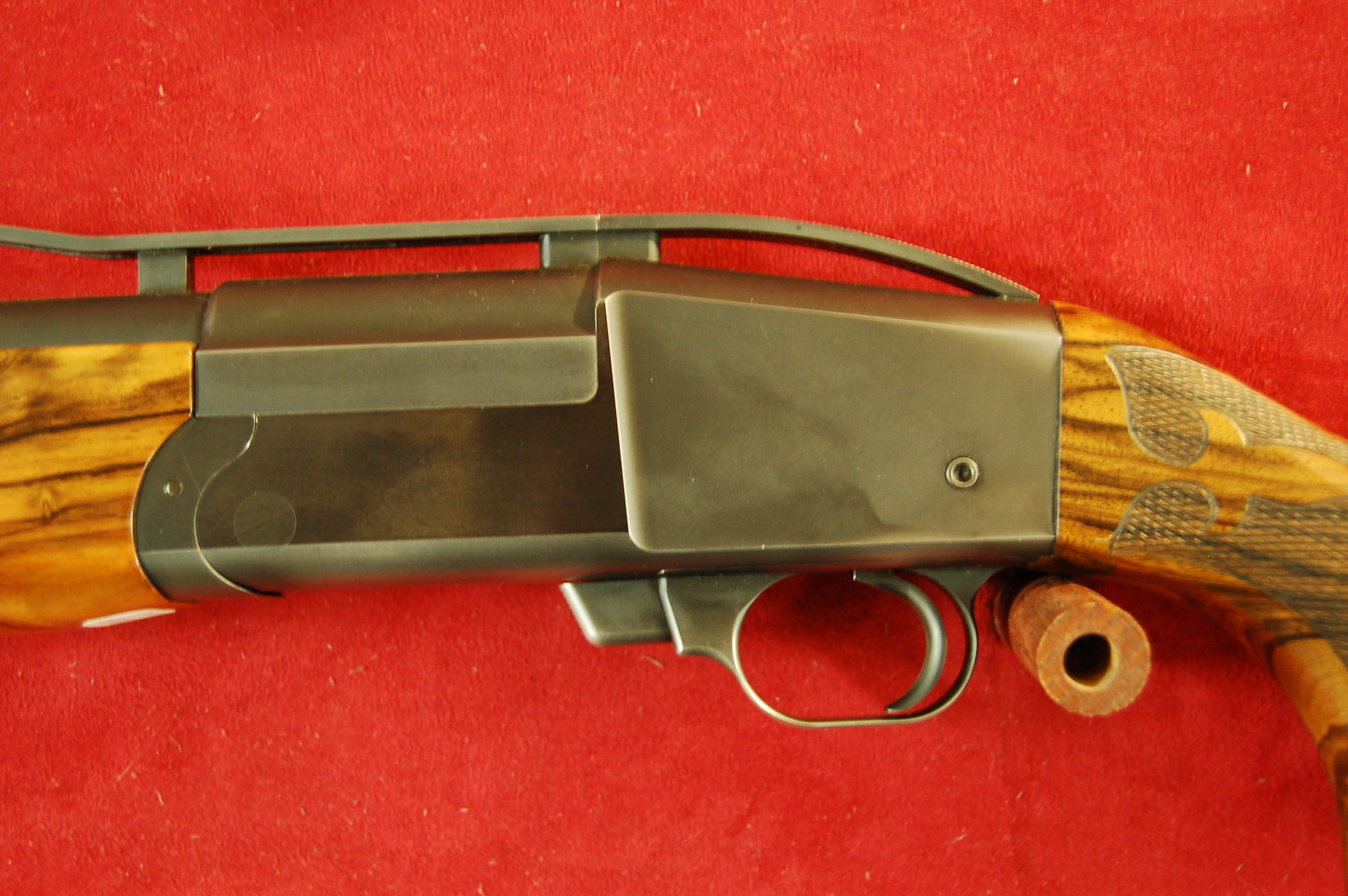 Left hand trap gun
